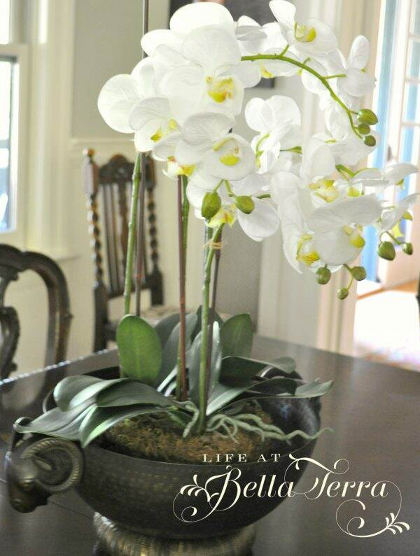 Of Artificial Orchids White Ones That Strongly Contrast The Dark Wood Table They Certainly Aren T As Detailed Real But Look