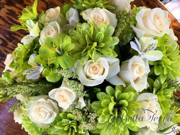 Arrangements using real and artificial flowers i made this for my daughter on st patricks day also her birthday and it was a simple combination of white roses and green faux flowers mightylinksfo